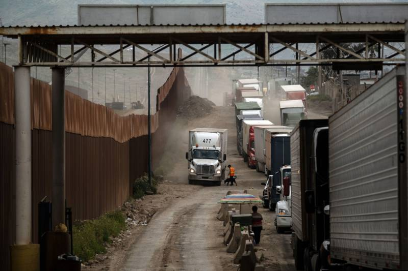 Border Delays Grow as Customs Officers Shift to Handle Surge in