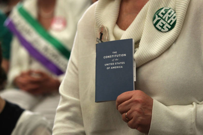 An activist holds a copy of the U.S. Constitution during a news conference on the Equal Rights Amendment on April 30, 2019, on Capitol Hill in Washington, D.C.