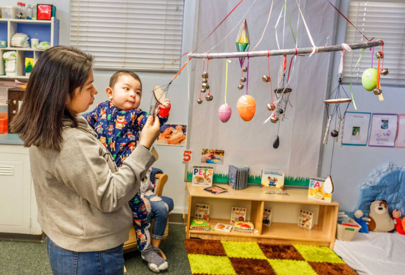 Alex Sandoval, age four months, begins his day at a child care center with his mom, Norma, playing with one of his favorite toys. Norma attends Yosemite High School while Alex attends the child care center attached to the school.