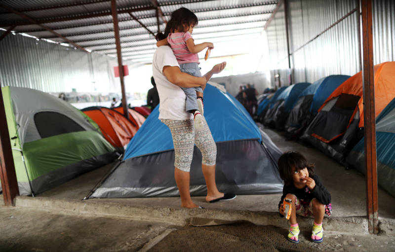 A Honduran mother stands with her daughters in the migrant shelter where they are currently living near the U.S.-Mexico border on April 4, 2019 in Tijuana. She said they are on the waiting list to apply for asylum in the U.S. and must wait at the shelter for now.