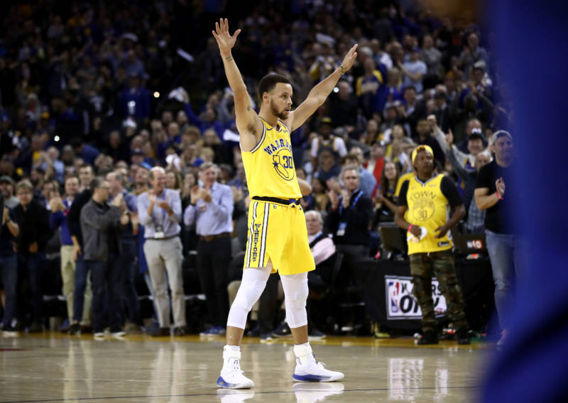 a6f1bc7cc215 Stephen Curry of the Golden State Warriors reacts after Kevin Durant dunked  the ball against the Denver Nuggets at Oracle Arena on April 2