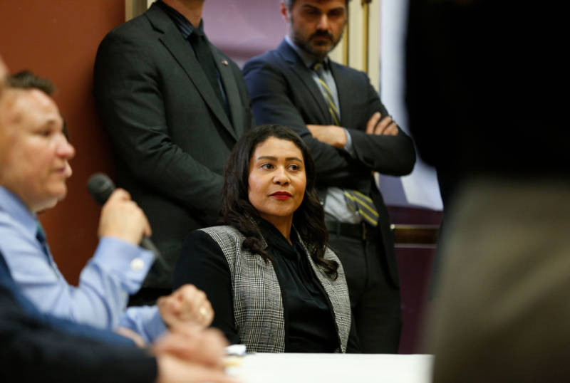 Mayor London Breed listens to comments after being shouted down at a community meeting on a proposed homeless navigation center in San Francisco.