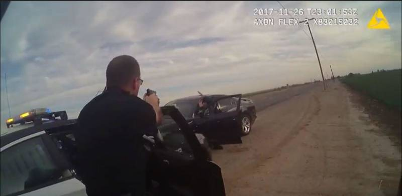 A still image from the body camera worn by Hanford Police Corporal Chris Barker shows his perspective on the standoff between law enforcement and Juan Castro.