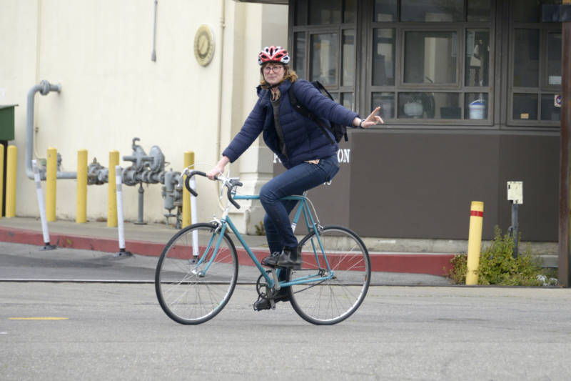 Sarah Hotchkiss uses a hand signal as she turns onto York Street in San Francisco on May 6, 2019.