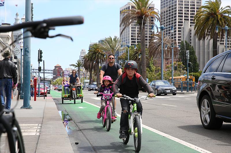 Families bike in San Francisco on July 18, 2014.