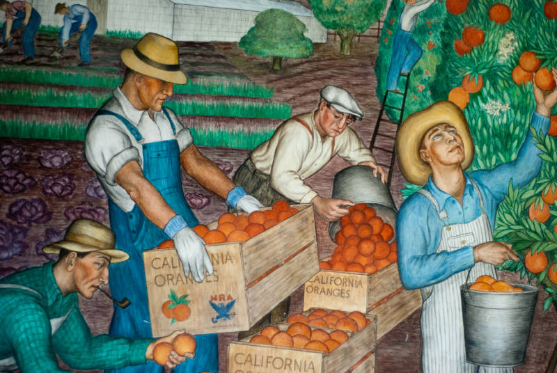 The Great Depression-era murals might be even more impressive than the view from the top.