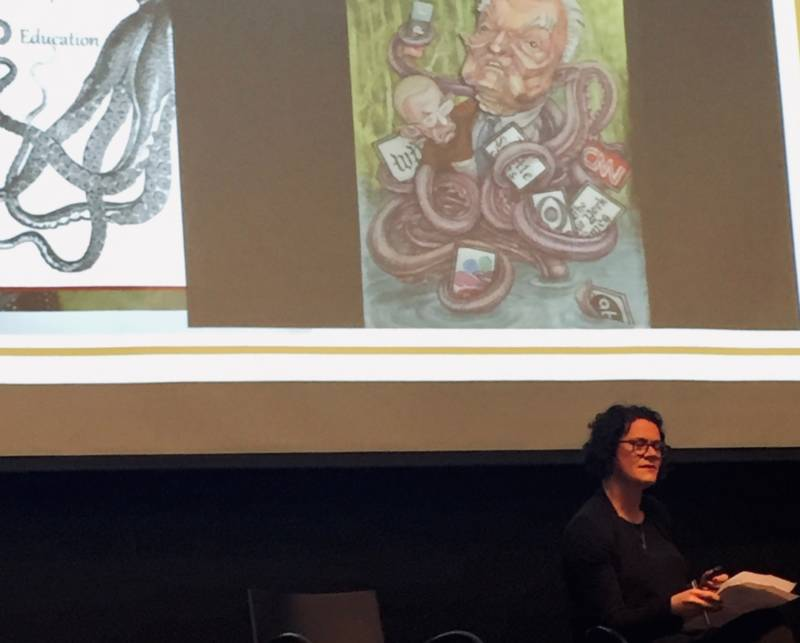 At a recent forum on anti-Semitism and the Internet, Rachel Deblinger, co-director of the Digital Jewish Studies Initiative at UC Santa Cruz, demonstrates how new, digital memes draw on ancient, non-digital tropes. Shown here: a recent cartoon of Hungarian-American investor and philanthropist George Soros, depicting him as a world-dominating spider, alongside something similar but much older.