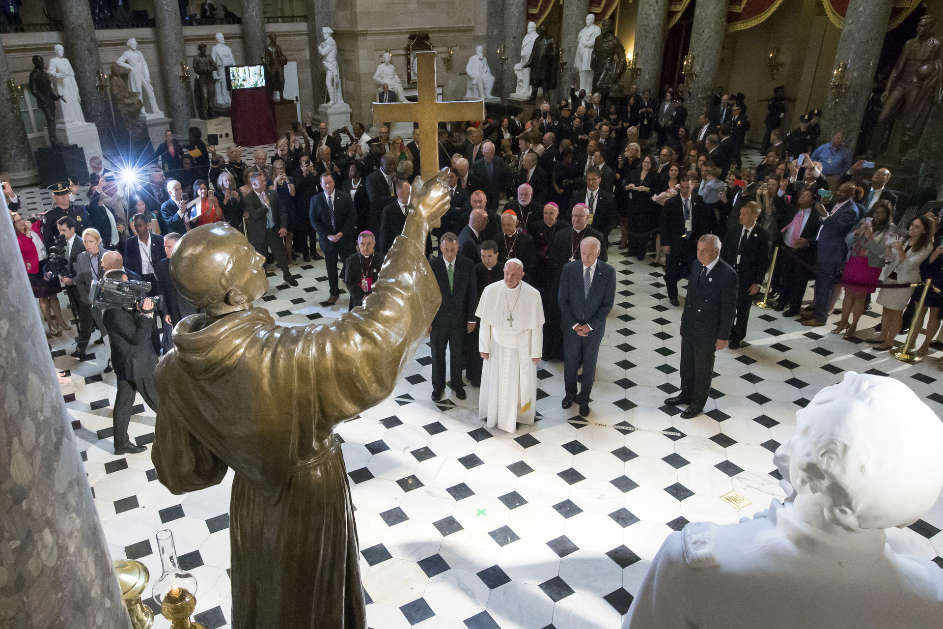 Pope Francis pauses in front of a sculpture of Spanish-born Junipero Serra, the Franciscan Friar known for starting missions in California, in Statuary Hall at the U.S. Capitol on September 24, 2015 in Washington, DC.