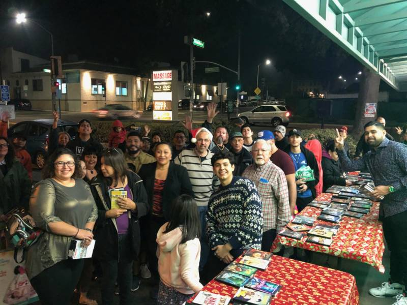Longtime customers turned out for Fastlane Video's annual Christmas giveaway.