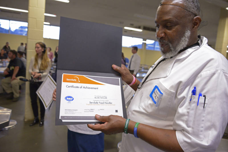Alvis Taylor shows off his ServSafe Food Handler's Certificate which comes in his diploma for graduation from the Quentin Cooks culinary program at San Quentin State Prison on May 22, 2019.