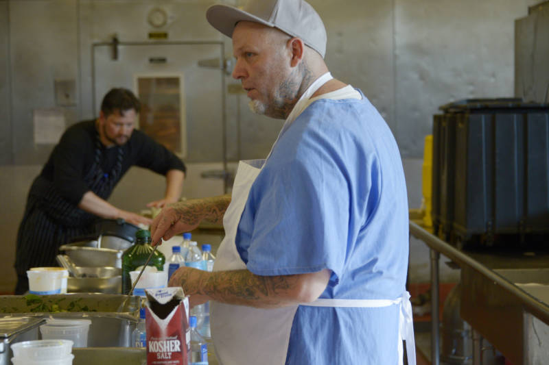 Art Ascheman, a current inmate from the fourth Quentin Cooks class, prepares food on May 22, 2019 ahead of the fifth graduation dinner.