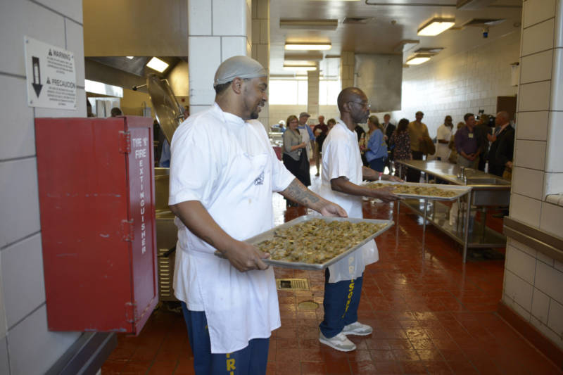 Inmates at San Quentin State Prison prepare shrimp for the fifth Quentin Cooks graduation dinner at San Quentin State Prison on May 22, 2019.