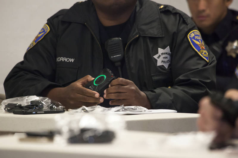 A San Francisco police officer turns on his body camera during training at the Ingleside police station in San Francisco on Sept. 1, 2016.