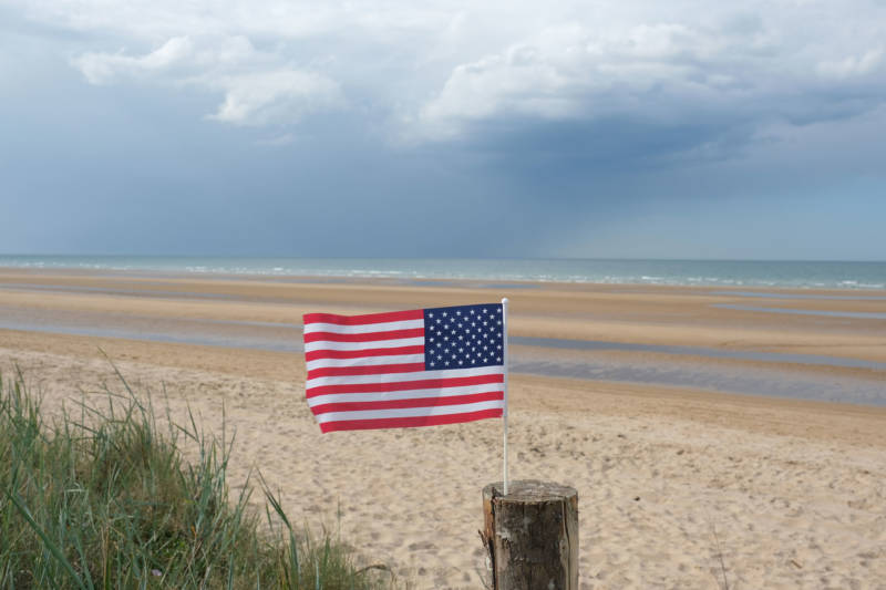 An American flag, likely left by a visitor, flies on Omaha Beach in Normandy on the 75th anniversary of the World War II Allied D-Day invasion on June 06, 2019 near Colleville-Sur-Mer, France.