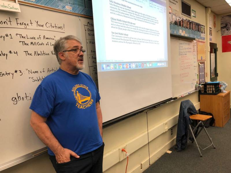 Cap Wilhelm-Safian leads a discussion with his 8th grade history class at Burnett Middle School about changing the school's name. Students have learned about Burnett's history and discussed the name change throughout the year.