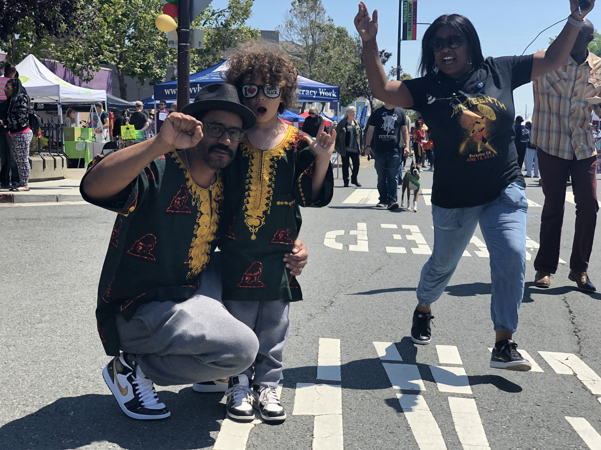 Dakh Jones and his son Enrico (and a Juneteenth photobomber) celebrate black pride in South Berkeley, where Jones was born and raised. 'It's significant that this celebration has not completely phased out, that it's still important for the Berkeley city,' he said.