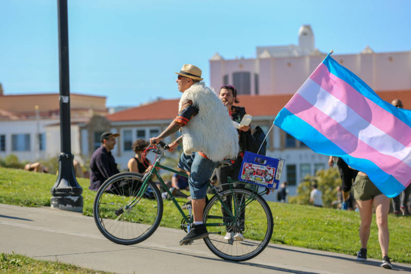 Enrique Cancél bikes through the Trans March crowd at Dolores Park. Cancél has lived in San Francisco for 25 years and attended every Pride celebration. 'This is a gathering of the tribes. This is when we come out in celebration and try to be as inclusive as we can be. It's wonderful.'