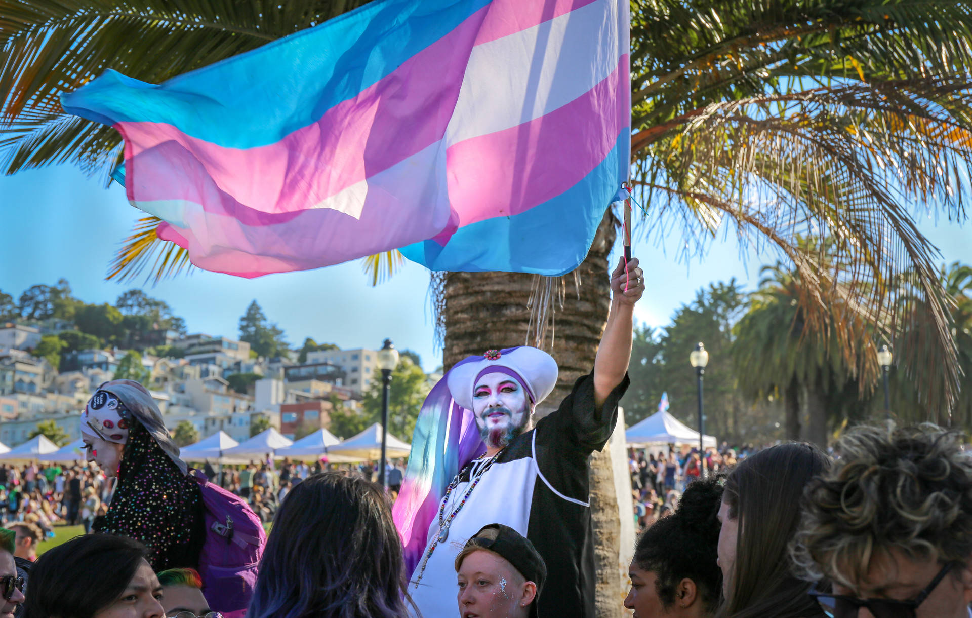 The transgender pride flag is held high during the Trans March at Dolores Park on June 28, 2019. Sruti Mamidanna/KQED