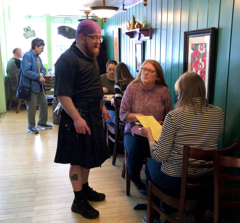 Tyx Pulskamp greets customers at Rosebud's Cafe. He says the restaurant has always been a safe space.