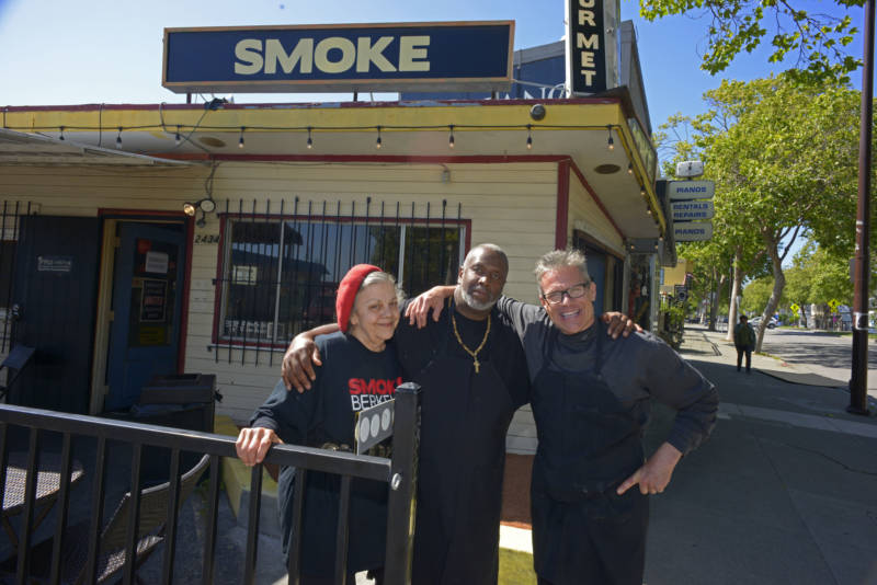 Tina Ferguson-Riffe (left) and Sean Hagler (right) stand with Joel McCarter (center) in front of Smoke Berkeley on May 28, 2019, in Berkeley. Ferguson-Riffe and Hagler hired McCarter after he graduated from the Quentin Cooks program at San Quentin State Prison.