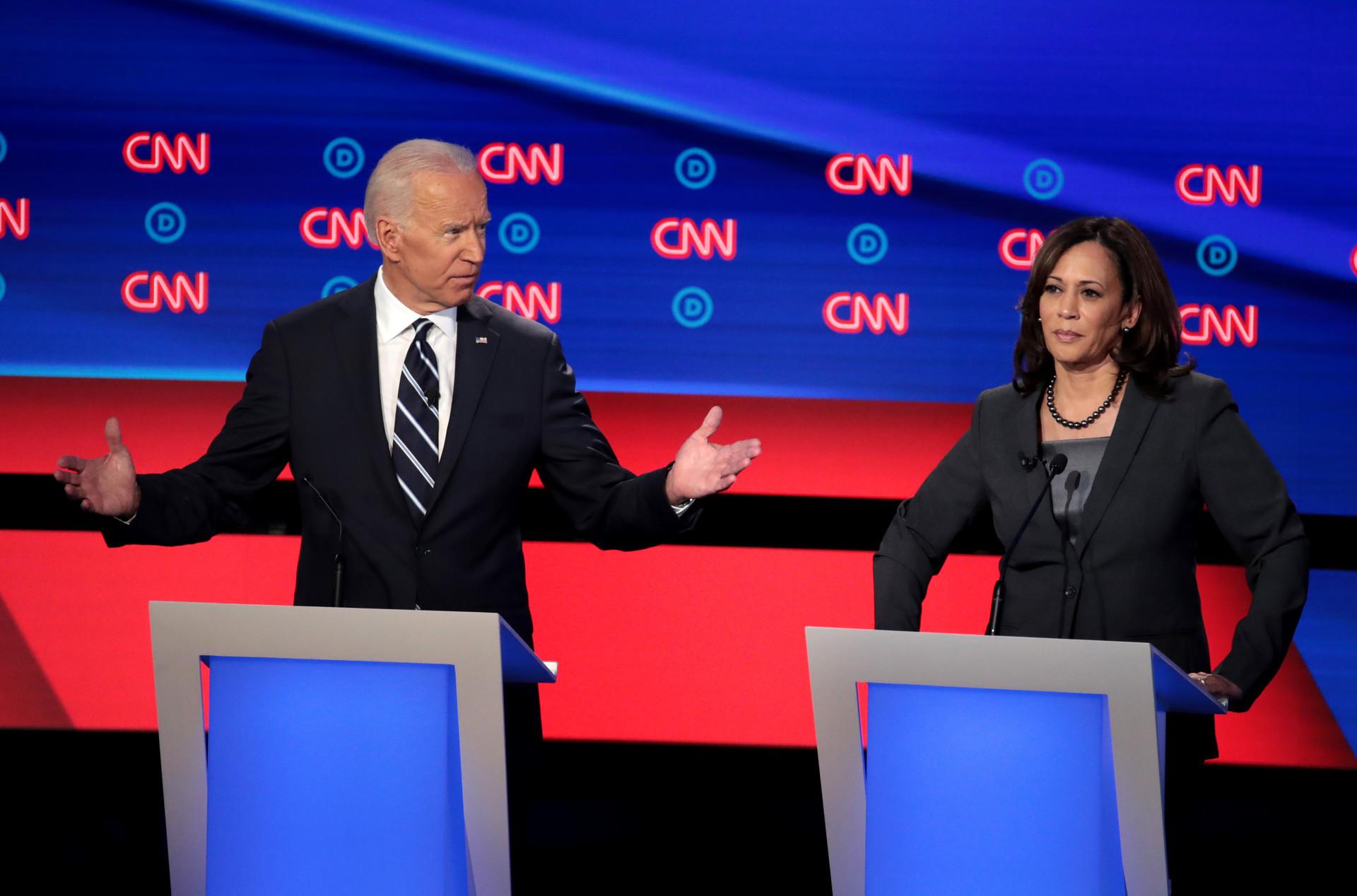 Democratic presidential candidate former Vice President Joe Biden (L) and Sen. Kamala Harris (D-CA) during the Democratic Presidential Debate at the Fox Theatre on July 31, 2019, in Detroit, Michigan.