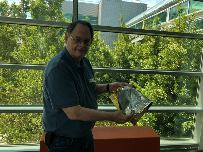 Chabot Space and Science Center astronomer Gerald McKeegan shows off some of the Apollo 11 spacesuit's 21 inner layers.