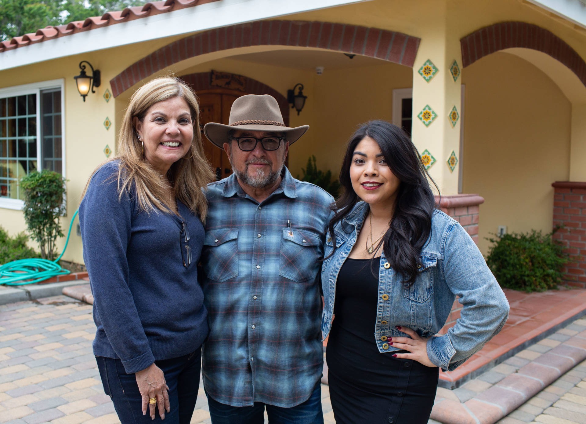 Helen, Juan, and Monica Rivera in front of their home, on May 26, 2019 in Chino. James Berna/KPCC
