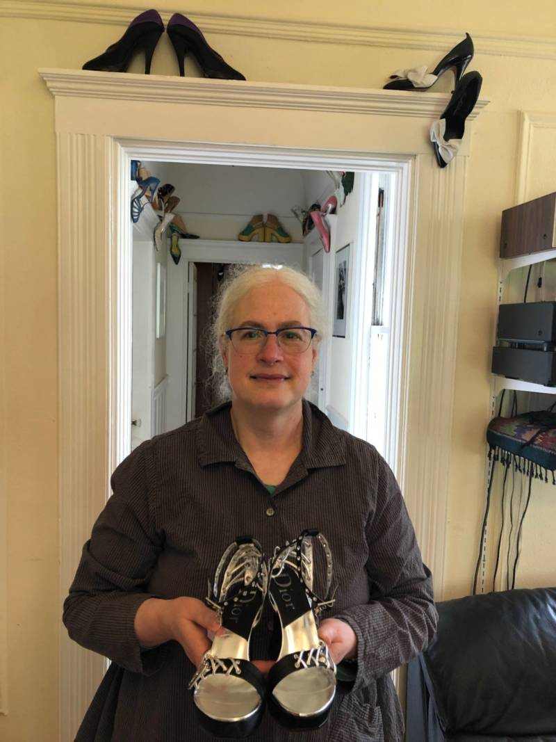 Fashion historian Melissa Leventon shows off a pair of shoes from her historic shoe collection at her home in San Francisco.
