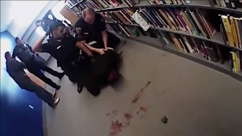 A screenshot from video footage of a March 17, 2016, arrest at the San Jose State University Dr. Martin Luther King Jr. Library. Officer Johnathon Silva was initially fired by the school system for excessive force, but he later won his job back on appeal.