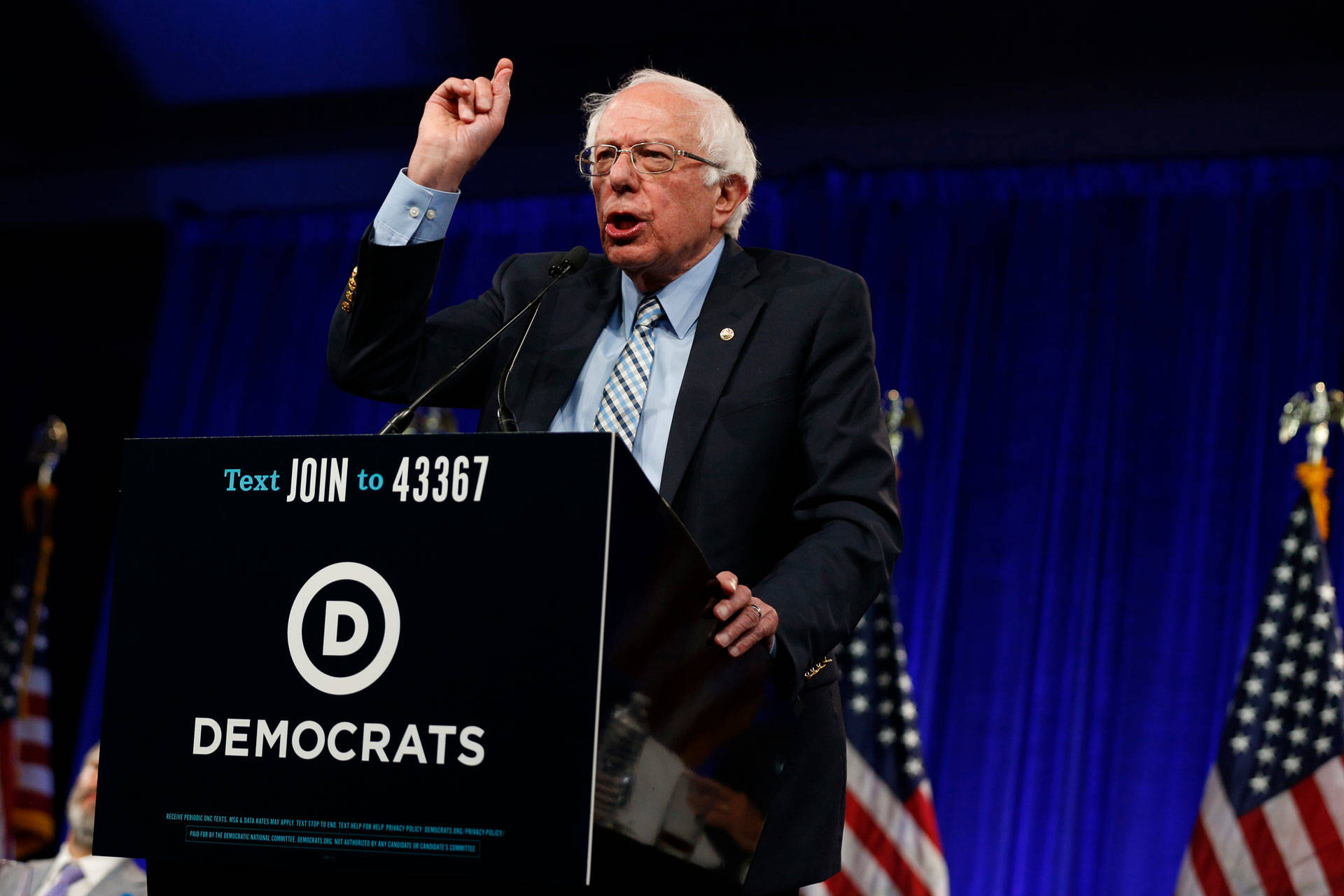 Addressing the DNC's summer meeting in San Francisco on Friday, Vermont Sen. Bernie Sanders stressed the importance of uniting to defeat 'the most dangerous president in American history.' Stephanie Lister/KQED