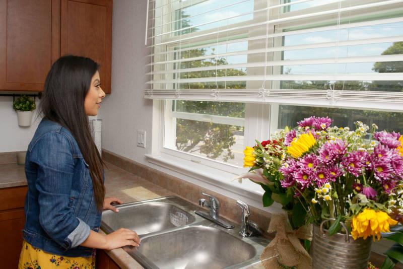 Julieta Aquino in her spotless new kitchen.