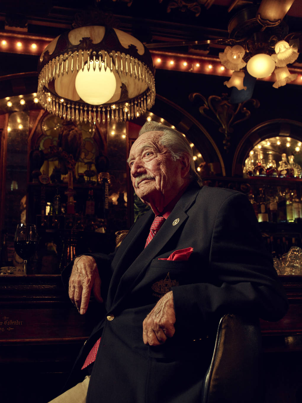 Milt Larsen, co-founder of the Magic Castle, sitting at the Owl Bar.