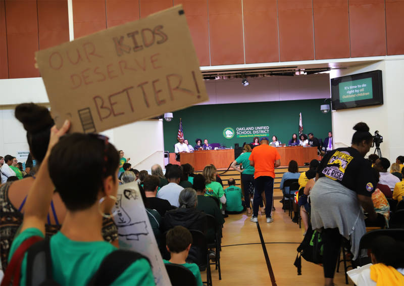 Attendees line up to speak at an Oakland school board meeting on Aug. 28, 2019.