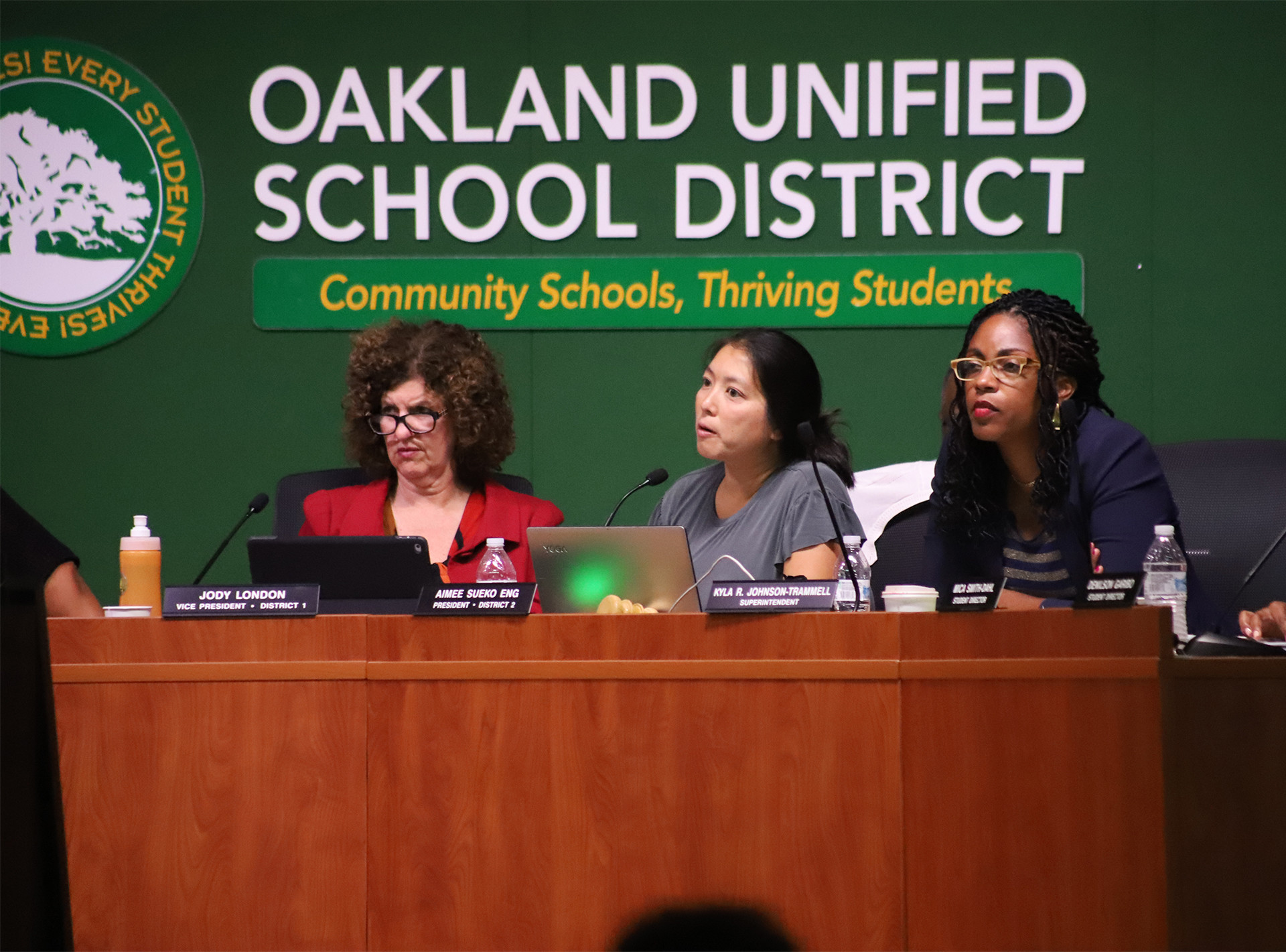 Oakland Unified School District Vice President Jody London, President Aimee Eng, and Superintendent Kyla Johnson-Trammell (left to right) listen to speakers at a school board meeting on Aug. 28, 2019.