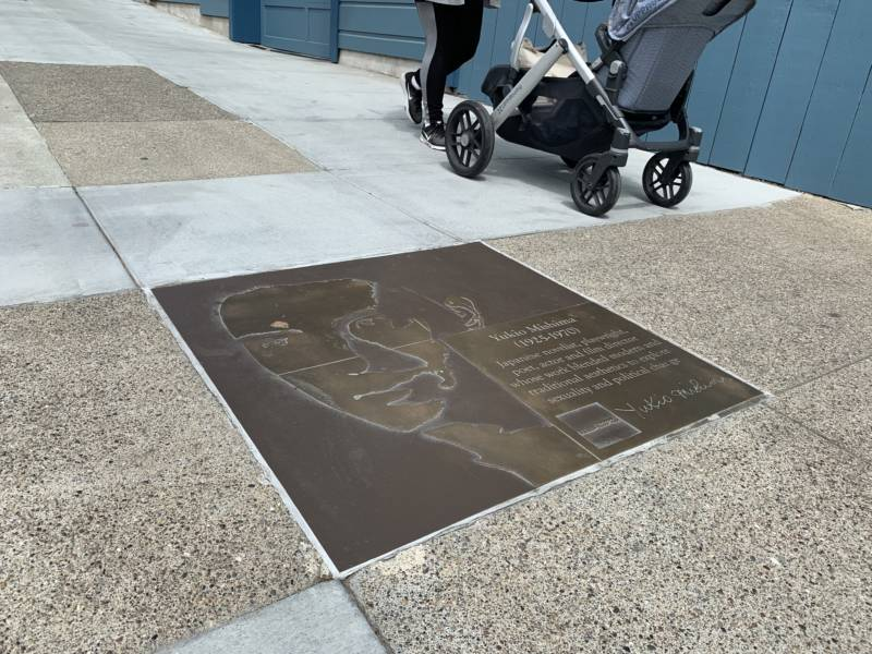 The sidewalk plaque of Yukio Mishima is situated on 19th Street in San Francisco, a quieter stretch of the Rainbow Honor Walk.