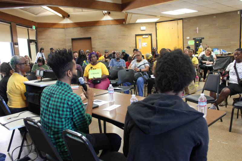 A panel featuring Darleen Flynn of the City of Oakland's Department of Race & Equity, Chanee Franklin Minor of the City of Oakland's Rent Adjustment Program, and Zachary Murray of the Oakland Community Land Trust discuss housing affordability and community land ownership at a Black Tenants Union meeting put on by ACCE in September 2019.