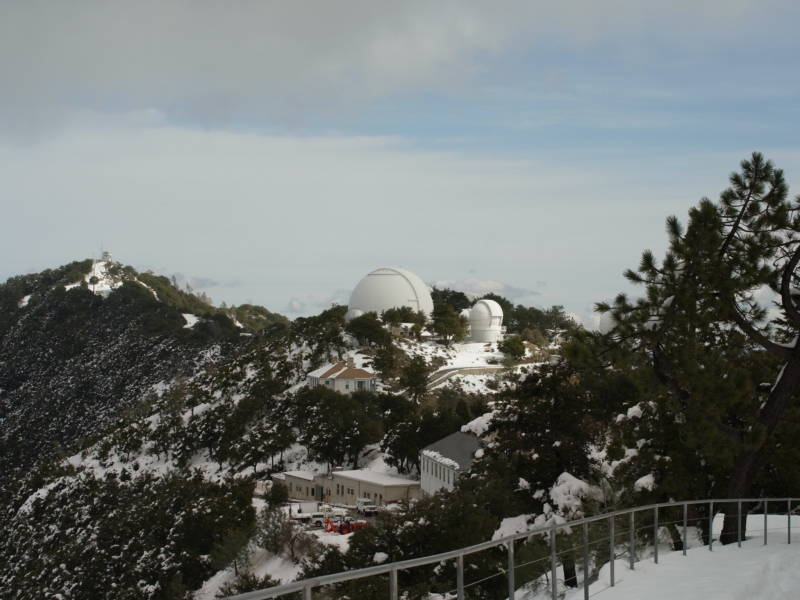The Lick Observatory peaking through the snow dusted top of Mount Hamilton.