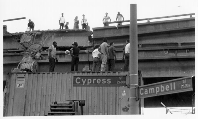 Residents and rescue workers on the Cypress freeway.