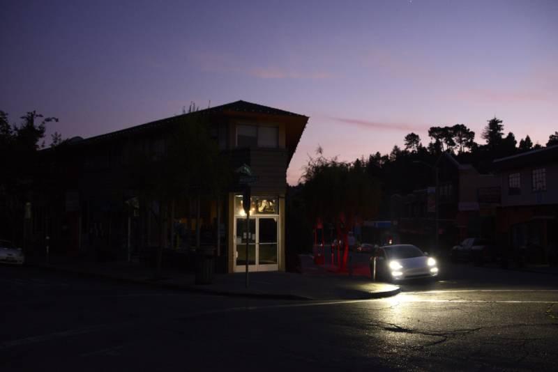The Public Safety Power Shutoffs darken a street corner in Oakland's Montclair neighborhood.