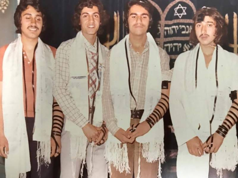 The reunion slideshow included photos of Jewish students in pre-Revolution Iran. At the time, Ettefagh School had a synagogue in the school, where both Jewish and non-Jewish students attended morning prayers together.