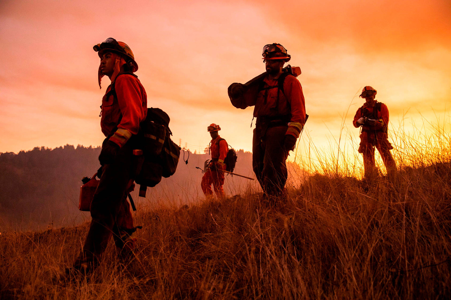 A crew of inmate firefighters make their way to firefighting operations to battle the Kincade Fire in Healdsburg on Oct. 26, 2019. Philip Pacheco/AFP via Getty Images
