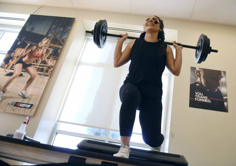 Photo of Ruby Sultan lifting weights.