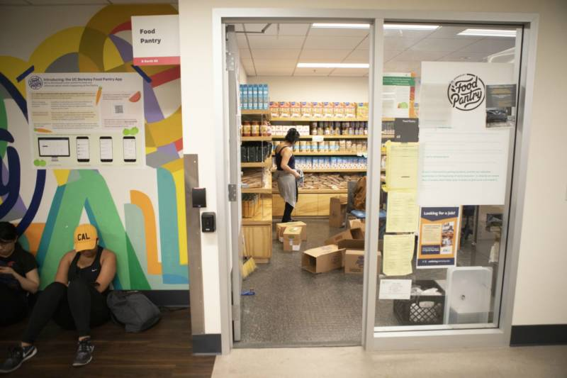 Photo of students sitting outside the food pantry room at UC Berkeley.