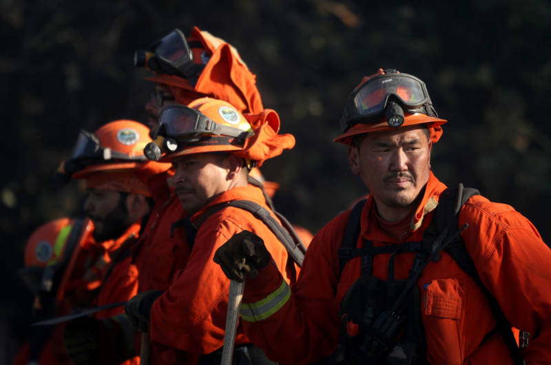 Inmate firefighters take a break while battling the Kincade Fire on Oct. 29, 2019 near Healdsburg.