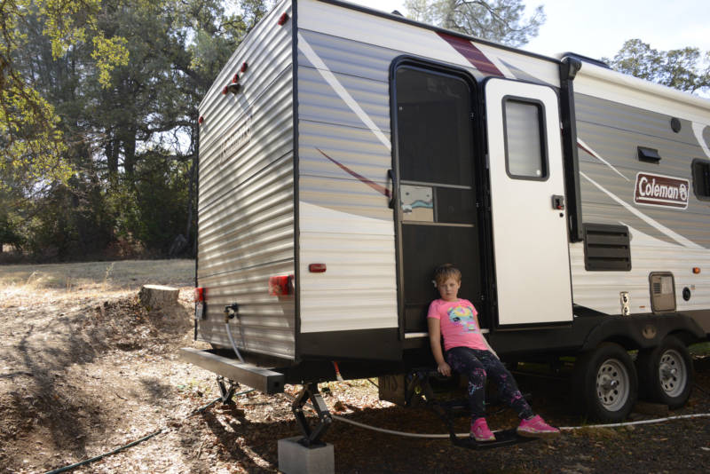 Aroara sits outside the trailer where she lives with her mother in Butte County.