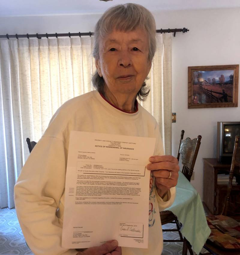 Emma Titus holds a letter of nonrenewal from her insurer, The Hartford. Her homeowners policy expired Nov. 14, 2019.
