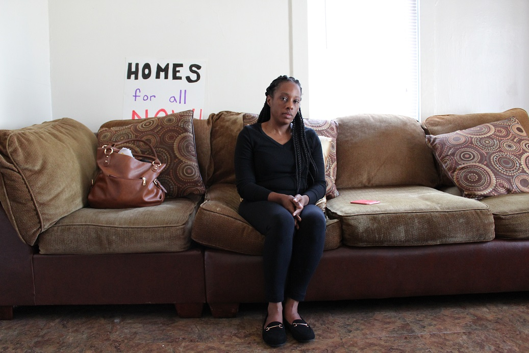 Dominique Walker, a member of the group Moms 4 Housing, sits in a West Oakland home that's been vacant for two years. Walker and other homeless mothers have been occupying the home since November.