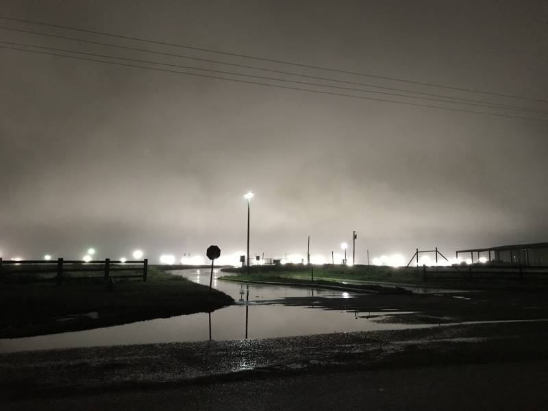 Flood lights illuminate the Immigration and Customs Enforcement family detention facility in Dilley, Texas.