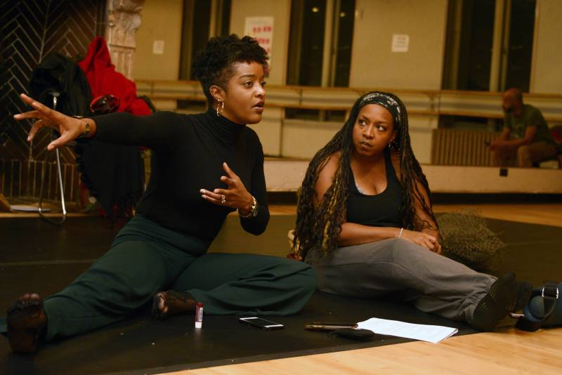 RyanNicole Peters, co-writer, co-director and lead dramatist (left) sits with Rozz Nash, executive director of The People's Conservatory, during a rehearsal at Malonga Casquelourd Center for the Arts in Oakland on Dec. 5, 2019.