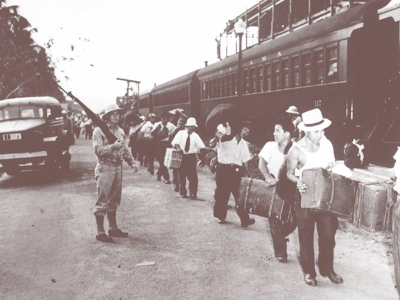 Japanese Peruvian men in the Panama Canal Zone heading to detention in the U.S., April 2, 1942. Koshio Henry Shima (2nd from right) was a named plaintiff in a 1996 lawsuit against the U.S. government seeking redress.
